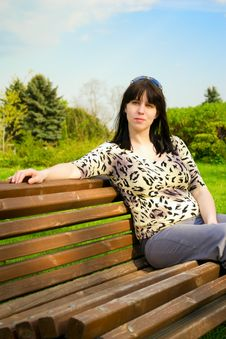 Free Young Woman Sits On A Bench Stock Images - 20031864