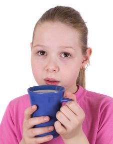 Free The Girl Drinks Milk From A Blue Cup Stock Photo - 20031970