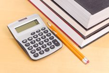 Free Calculator With Textbooks Royalty Free Stock Photography - 20032727