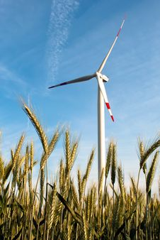 A Wind Turbine On The Field Stock Photo