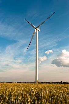 A Wind Turbine On The Field Stock Images