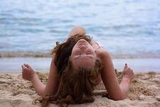 Free A Pretty Woman In Bikini Sunbathing At The Beach Stock Photography - 20033302