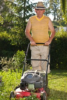 Free Man Mowing The Lawn Stock Photos - 20033413