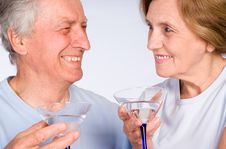Free Aged Couple With Glass Stock Image - 20033661