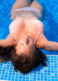 Woman Relaxing In Blue Outdoor Swimming Waterpool Royalty Free Stock Photo