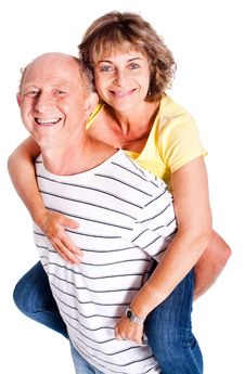 Free Senior Man Giving Woman Piggyback Ride Stock Image - 20039361
