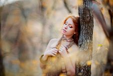 Free The Red-haired Girl In Autumn Leaves Stock Images - 20039414