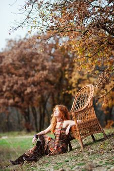 Free The Red-haired Girl In Autumn Leaves Royalty Free Stock Photo - 20039415