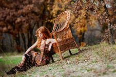 Free The Red-haired Girl In Autumn Leaves Royalty Free Stock Image - 20039416
