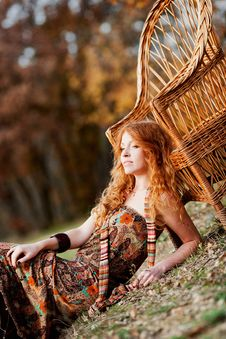 Free The Red-haired Girl In Autumn Leaves Royalty Free Stock Images - 20039419