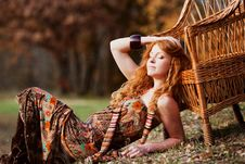 Free The Red-haired Girl In Autumn Leaves Stock Photos - 20039423