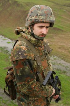 Free Portrait Of Soldier With A Rifle Stock Photos - 20039953