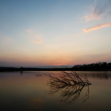 Tranquil Scene Of Sunset At The Lake Stock Images