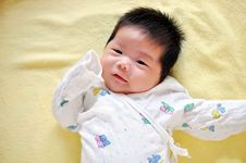 Free Baby Lying On The Bed Stock Image - 20040501
