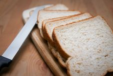 Sliced Bread With Knife And Cutting Board. Stock Images