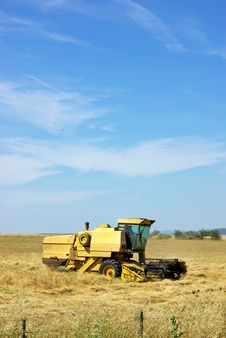 Combine Harvester Working A Wheat Field. Stock Image