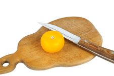 Free Tomato With A Knife On A Cutting Board Royalty Free Stock Images - 20047089