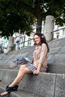 Free Smiling Latina Looking At Pigeon Royalty Free Stock Images - 20047289
