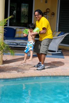 Free Adorable Hispanic Child With His Father By Pool Stock Photography - 20049222