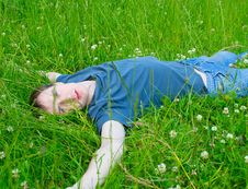 Free The Young Man Lies On A Green Grass Royalty Free Stock Photo - 20049575