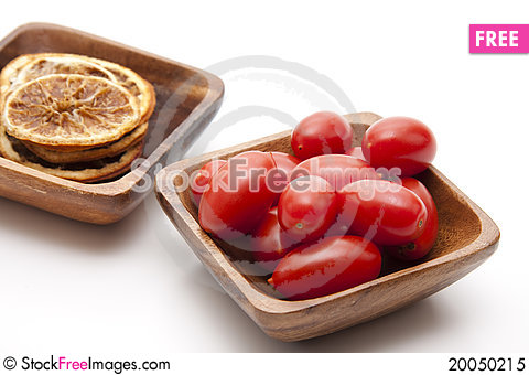 Cocktail tomatoes and lemons Stock Photo