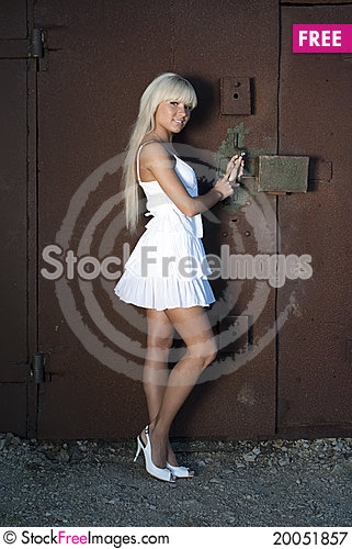 Girl opens old garage Stock Photo