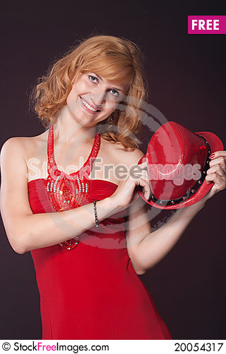Free Red-haired Girl In A Red Dress And Red Hat Royalty Free Stock Photography - 20054317