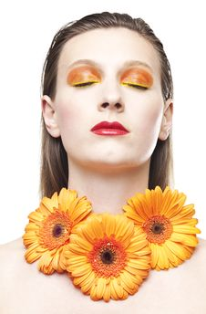 Young Woman With Colorful Make-up And Gerbera Royalty Free Stock Photography