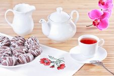 Cup Of Tea, Teapot And Chocolate Iced Spice Cakes Stock Photo