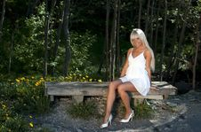 Free Girl Sitting On A Bench In The Woods Royalty Free Stock Image - 20051726
