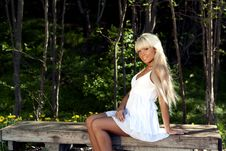 Free Girl Sitting On A Bench In The Woods Stock Image - 20051741