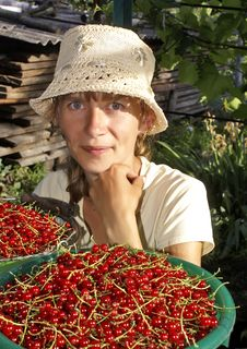 Free The Young Woman And Red Currant. Stock Photos - 20052893
