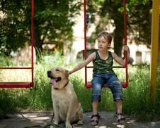 Little Boy Sitting On A Swing Royalty Free Stock Photo