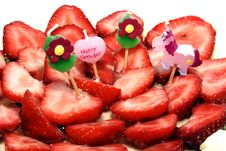 Four Candles On A Strawberry Birthday Cake Stock Image