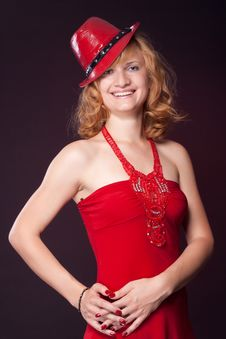 Free Red-haired Girl In A Red Dress And Red Hat Royalty Free Stock Photography - 20054297