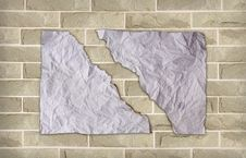 Free Burn Crease Paper On Brick Wall Stock Photography - 20054422