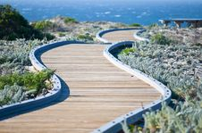 Free Winding Wooden Walkway Leading Towards The Ocean Stock Images - 20054924