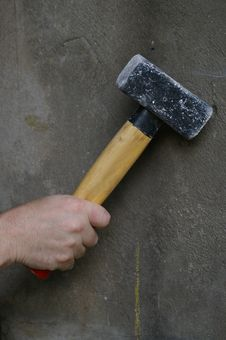 Free Hand With Hammer On Grey Wall Stock Photography - 20056142