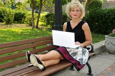Free Adult Woman On A Laptop In A Park Stock Image - 20056421