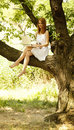 Free Girl Sitting At Tree With Notebook. Royalty Free Stock Photo - 20064295