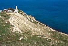 Free White Lighthouse On Sea Coast Royalty Free Stock Photography - 20060607