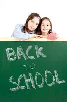 Two Girls With Blackboard Stock Images