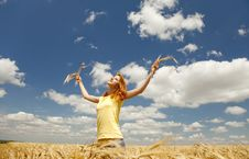 Girl At Wheat Field At Summertime. Royalty Free Stock Images