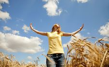 Girl At Wheat Field At Summertime. Stock Photo