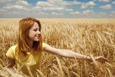 Girl At Wheat Field At Summertime. Stock Images