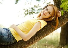 Free Girl With Headphones Lie Over Tree Stock Images - 20064084
