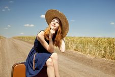 Free Girl With Suitcase At Country Road. Stock Images - 20064224
