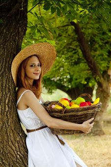 Free Redhead Girl With Fruit At Garden. Stock Image - 20064291
