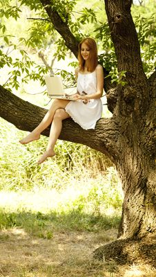 Girl Sitting At Tree With Notebook. Royalty Free Stock Photo