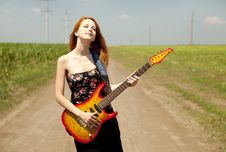 Free Girl With Guitar At Countryside. Royalty Free Stock Photo - 20064445